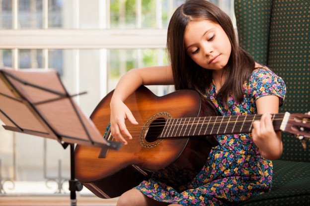 Image result for child playing guitar